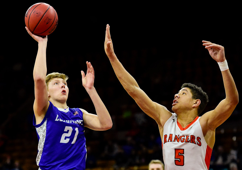 . Longmont High School\'s Dallas Dye (No. 21) Lewis Palmer High School\'s Joel Scott (No. 5) in the class 4A state basketball final at the Denver Coliseum in Denver, Colorado on March 10, 2018. (Photo by Matthew Jonas/Staff Photographer)