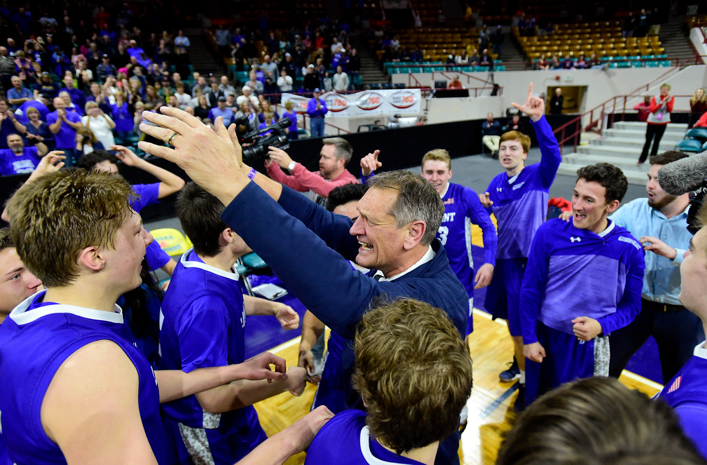 . Longmont High School head coach Jeff Kloster is surrounded by his team after they defeated Lewis Palmer High School in the class 4A state basketball final at the Denver Coliseum in Denver, Colorado on March 10, 2018. (Photo by Matthew Jonas/Staff Photographer)