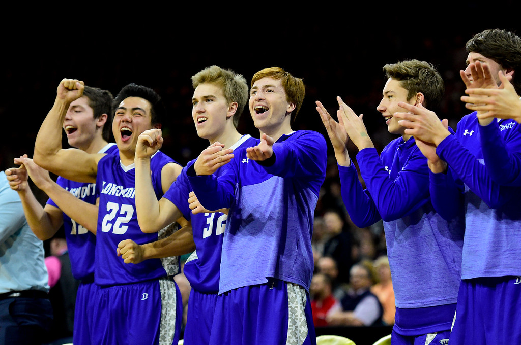 . Longmont High School\'s bench celebrates a basket against Lewis Palmer High School in the class 4A state basketball final at the Denver Coliseum in Denver, Colorado on March 10, 2018. (Photo by Matthew Jonas/Staff Photographer)