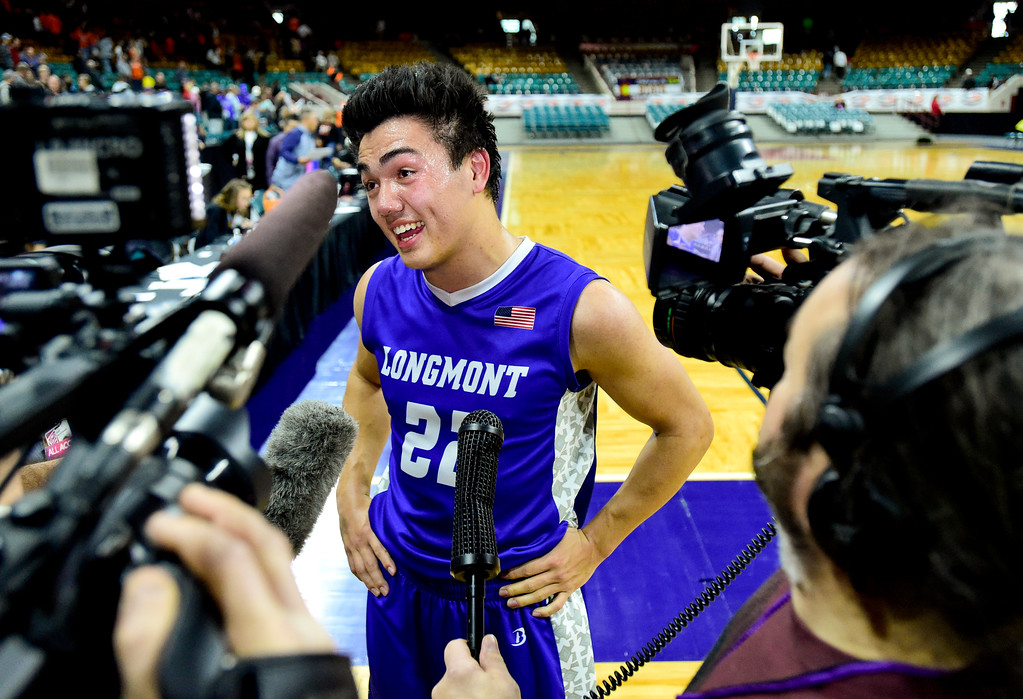 . Longmont High School\'s Oakley Dehning (No. 22) talks to reporters after their win over Lewis Palmer High School in the class 4A state basketball final at the Denver Coliseum in Denver, Colorado on March 10, 2018. (Photo by Matthew Jonas/Staff Photographer)