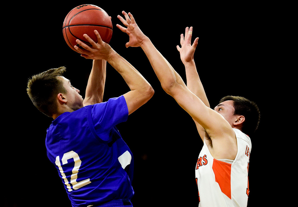 . DENVER, CO - MARCH 9:Longmont High School\'s Brady Renck (No. 12) Lewis Palmer High School\'s Noah Baca (No. 10) during the 4A state basketball final at the Denver Coliseum on March 9, 2019. The Trojans were defeated by the Rangers, 57-52. (Photo by Matthew Jonas/Staff Photographer)