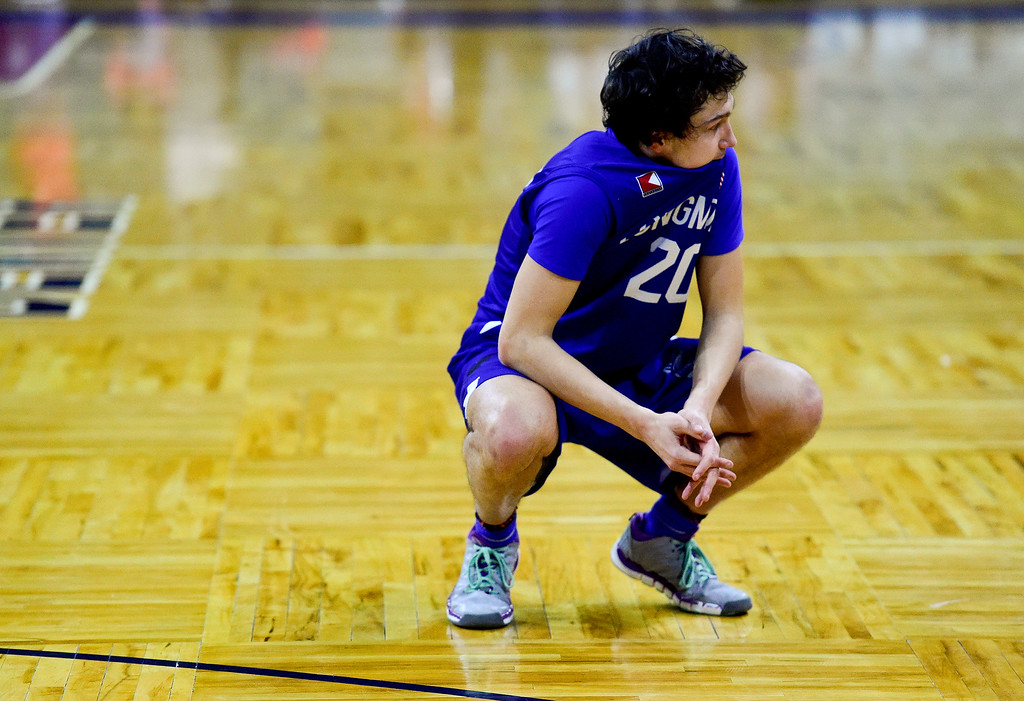 . DENVER, CO - MARCH 9:Longmont High School\'s Jaydon Elkins (No. 20) reacts after losing to Lewis Palmer High School during the 4A state basketball final at the Denver Coliseum on March 9, 2019. The Trojans were defeated by the Rangers, 57-52. (Photo by Matthew Jonas/Staff Photographer)