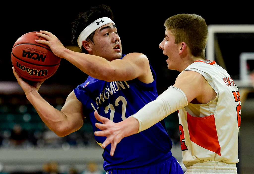 . DENVER, CO - MARCH 9:Longmont High School\'s Oakley Dehning (No. 22) looks to pass while covered by Lewis Palmer High School\'s Matthew Ragsdale (No. 22) during the 4A state basketball final at the Denver Coliseum on March 9, 2019. The Trojans were defeated by the Rangers, 57-52. (Photo by Matthew Jonas/Staff Photographer)