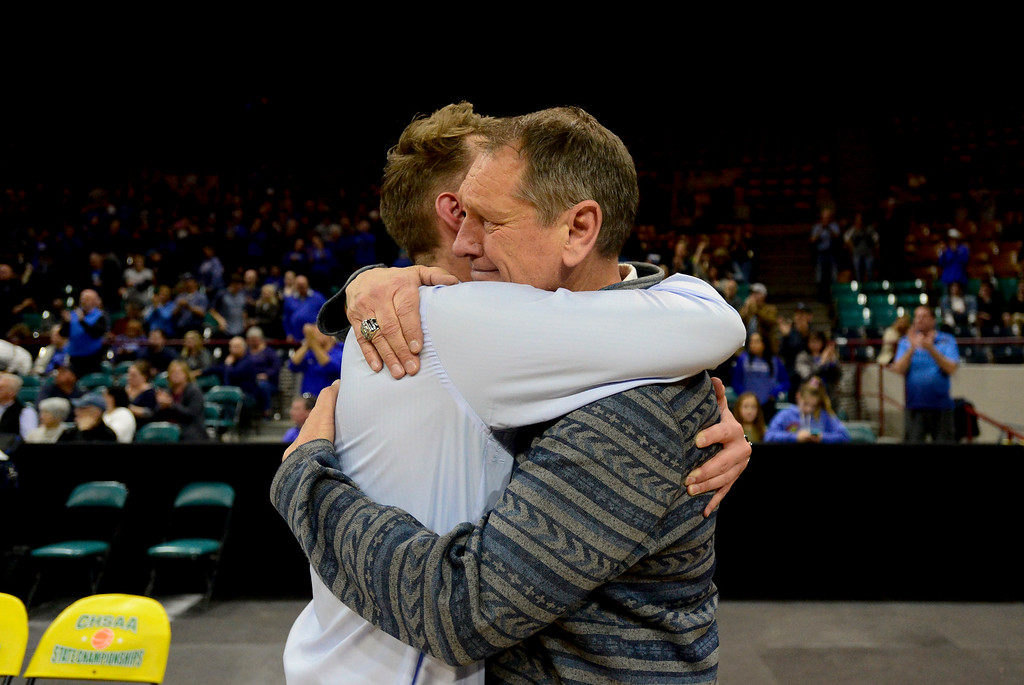 . DENVER, CO - MARCH 9:Longmont High School\'s Head Coache Jeff Kloster, right, hugs Assistant Coach Cade Kloster after they were defeated by Lewis Palmer High School during the 4A state basketball final at the Denver Coliseum on March 9, 2019. The Trojans were defeated by the Rangers, 57-52. (Photo by Matthew Jonas/Staff Photographer)