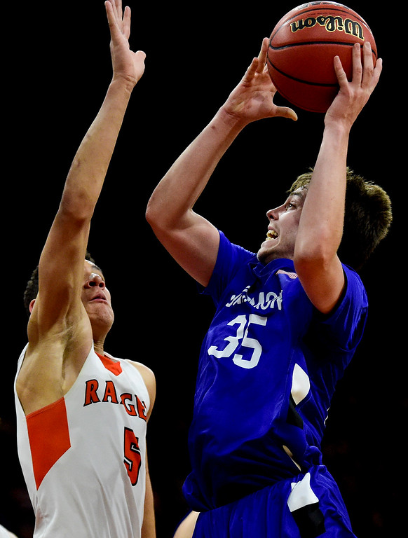 . DENVER, CO - MARCH 9:Longmont High School\'s Calvin Seamons (No. 35) shoots over Lewis Palmer High School\'s Joel Scott (No. 5) during the 4A state basketball final at the Denver Coliseum on March 9, 2019. The Trojans were defeated by the Rangers, 57-52. (Photo by Matthew Jonas/Staff Photographer)