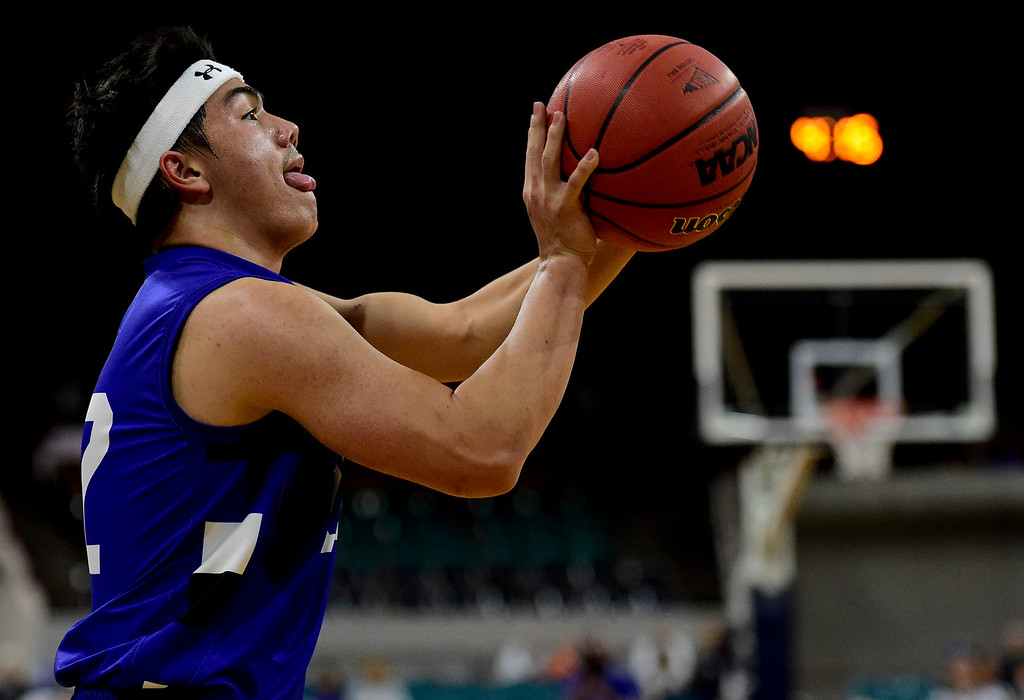 . DENVER, CO - MARCH 9:Longmont High School\'s Oakley Dehning (No. 22) shoots from three point territory in the game against Lewis Palmer High School during the 4A state basketball final at the Denver Coliseum on March 9, 2019. The Trojans were defeated by the Rangers, 57-52. (Photo by Matthew Jonas/Staff Photographer)