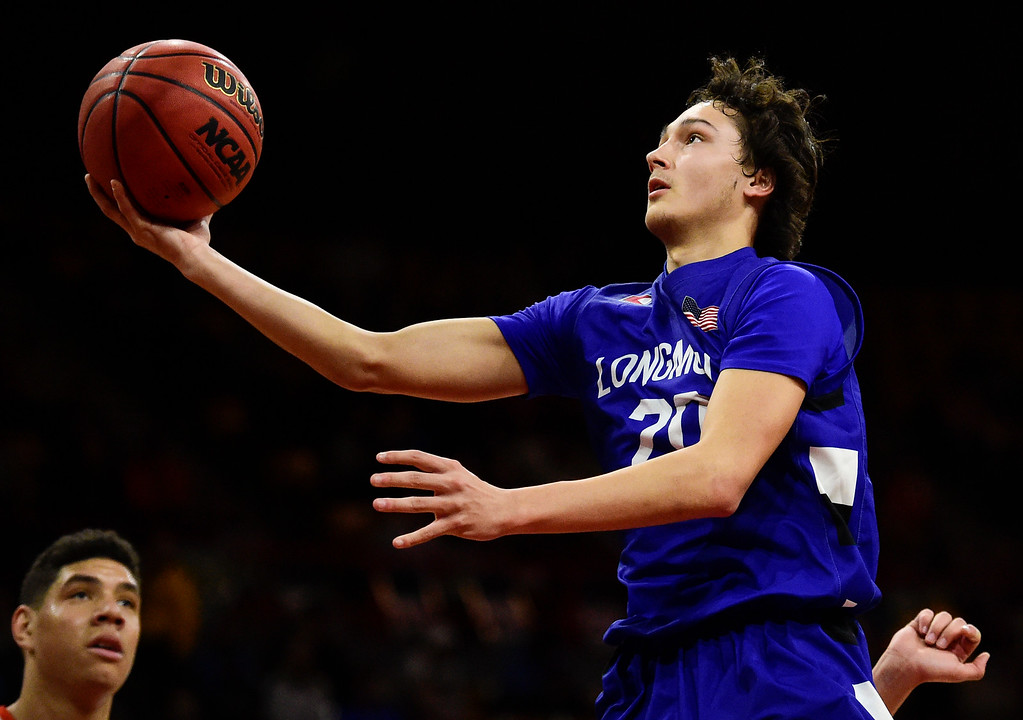 . DENVER, CO - MARCH 9:Longmont High School\'s Jaydon Elkins (No. 20) shoots during the game against Lewis Palmer High School during the 4A state basketball final at the Denver Coliseum on March 9, 2019. The Trojans were defeated by the Rangers, 57-52. (Photo by Matthew Jonas/Staff Photographer)