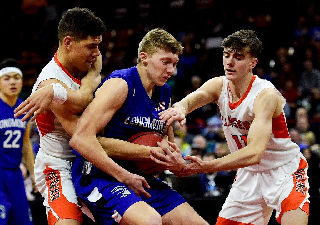 . DENVER, CO - MARCH 9:Longmont High School\'s (No.) battles for possession with Lewis Palmer High School\'s Joel Scott (No. 5) and Ethan Forrester (No. 11) during the 4A state basketball final at the Denver Coliseum on March 9, 2019. The Trojans were defeated by the Rangers, 57-52. (Photo by Matthew Jonas/Staff Photographer)