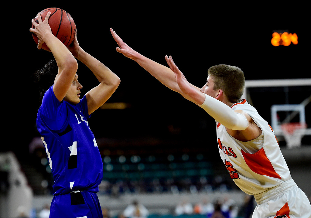 . DENVER, CO - MARCH 9:Longmont High School\'s Jaydon Elkins (No. 20) looks to pass while covered by Lewis Palmer High School\'s Matthew Ragsdale (No. 22) during the 4A state basketball final at the Denver Coliseum on March 9, 2019. The Trojans were defeated by the Rangers, 57-52. (Photo by Matthew Jonas/Staff Photographer)