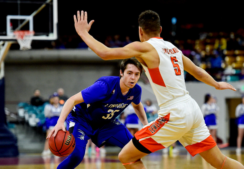 . DENVER, CO - MARCH 9:Longmont High School\'s Calvin Seamons (No. 35) looks to pass while covered by Lewis Palmer High School\'s Joel Scott (No. 5) during the 4A state basketball final at the Denver Coliseum on March 9, 2019. The Trojans were defeated by the Rangers, 57-52. (Photo by Matthew Jonas/Staff Photographer)