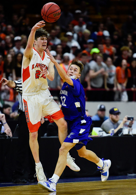 . DENVER, CO - MARCH 9:Longmont High School\'s Brady Renck (No. 12) tries to block the pass from Lewis Palmer High School\'s Dominic Roma (No. 24) during the 4A state basketball final at the Denver Coliseum on March 9, 2019. The Trojans were defeated by the Rangers, 57-52. (Photo by Matthew Jonas/Staff Photographer)