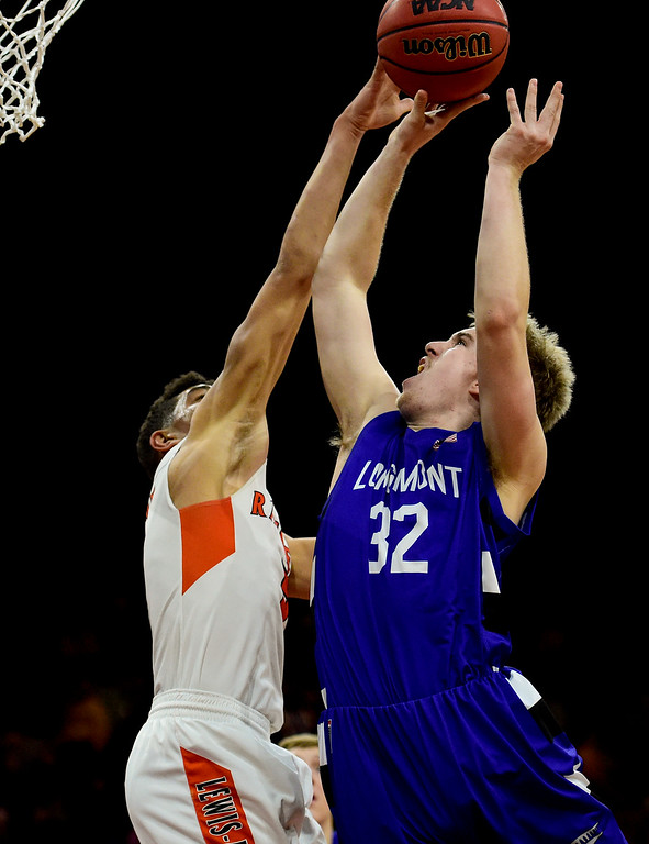 . DENVER, CO - MARCH 9:Longmont High School\'s Beck Page (No. 32) shoots over Lewis Palmer High School\'s Joel Scott (No. 5) during the 4A state basketball final at the Denver Coliseum on March 9, 2019. The Trojans were defeated by the Rangers, 57-52. (Photo by Matthew Jonas/Staff Photographer)