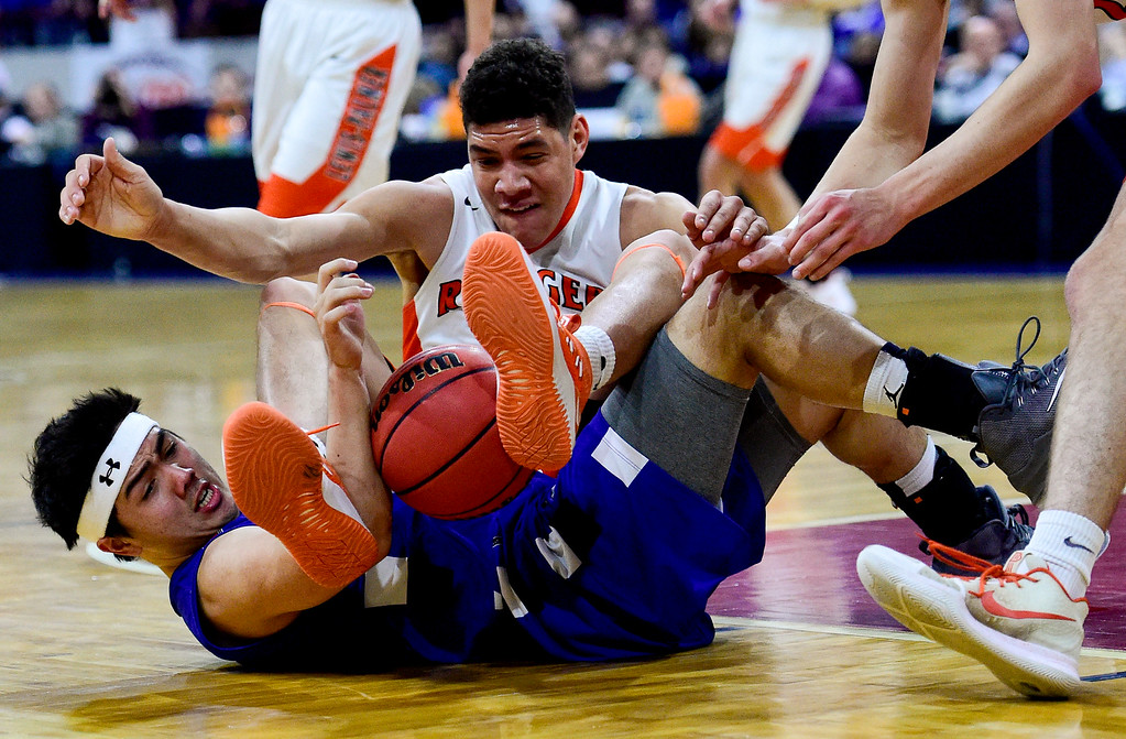. DENVER, CO - MARCH 9:Longmont High School\'s Oakley Dehning (No. 22) battles for possession of the ball with Lewis Palmer High School\'s Joel Scott (No. 5) during the 4A state basketball final at the Denver Coliseum on March 9, 2019. The Trojans were defeated by the Rangers, 57-52. (Photo by Matthew Jonas/Staff Photographer)