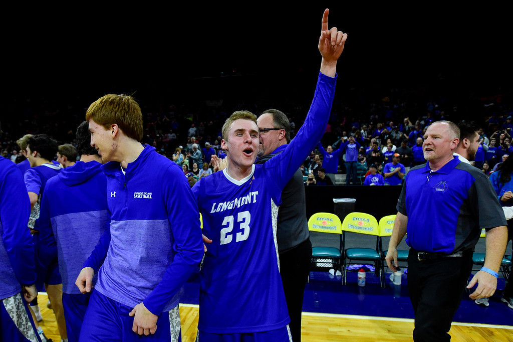 . Longmont High School\'s Caden Dion (No. 23) celebrates a win with his team over Pueblo South High School in the class 4A state basketball final four game at the Denver Coliseum in Denver, Colorado on March 9, 2018. (Photo by Matthew Jonas/Staff Photographer)