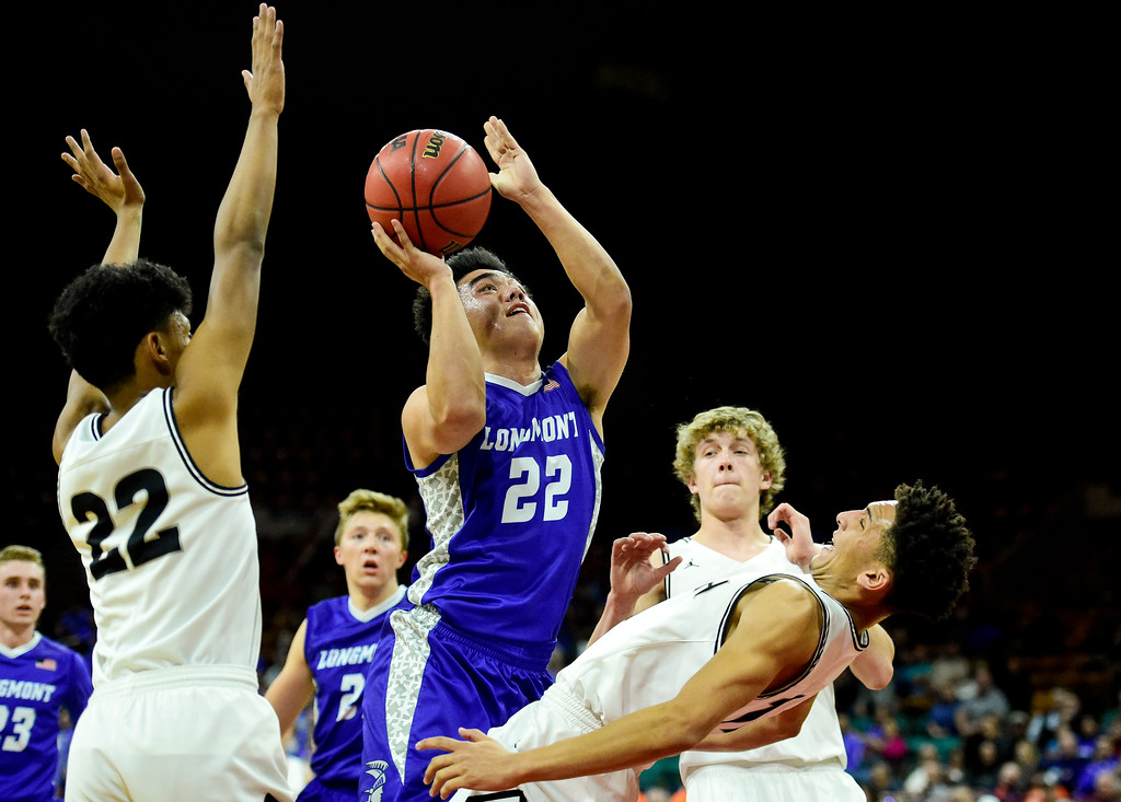 . Longmont High School\'s Oakley Dehning (No. 22) shoots over Pueblo South High School\'s Marcell Barbee (No. 11) in the class 4A state basketball final four game at the Denver Coliseum in Denver, Colorado on March 9, 2018. (Photo by Matthew Jonas/Staff Photographer)