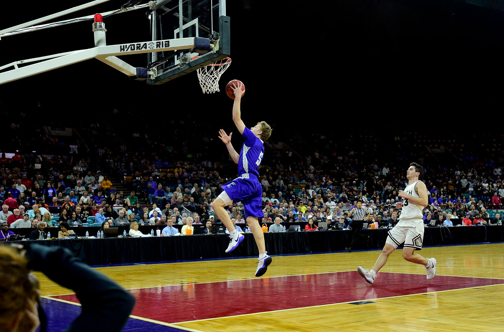 . Longmont High School\'s Luke Johnson (No. 5) puts in a basket in the fourth quarter as they pull away from Pueblo South High School in the class 4A state basketball final four game at the Denver Coliseum in Denver, Colorado on March 9, 2018. (Photo by Matthew Jonas/Staff Photographer)