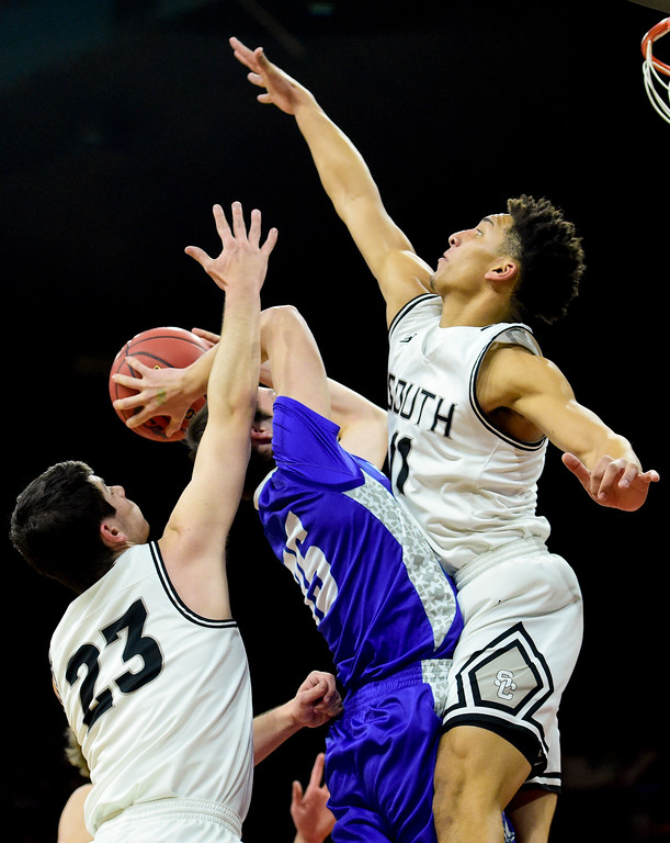 . Longmont High School\'s Calvin Seamons (No. 35) tries to shoot between Pueblo South High School\'s David Caporicci (No. 23) and Marcell Barbee (No. 11) in the class 4A state basketball final four game at the Denver Coliseum in Denver, Colorado on March 9, 2018. (Photo by Matthew Jonas/Staff Photographer)