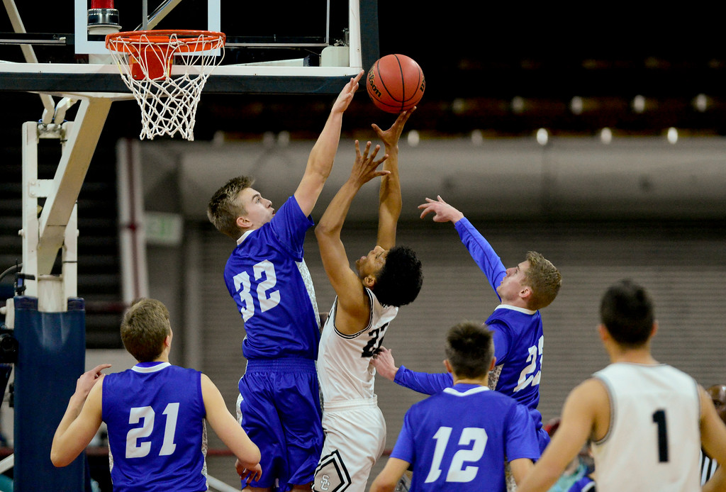 . Longmont High School\'s Beck Page (No. 32) jumps to block a shot from Pueblo South High School\'s Tonay Aragon (No. 22) in the class 4A state basketball final four game at the Denver Coliseum in Denver, Colorado on March 9, 2018. (Photo by Matthew Jonas/Staff Photographer)