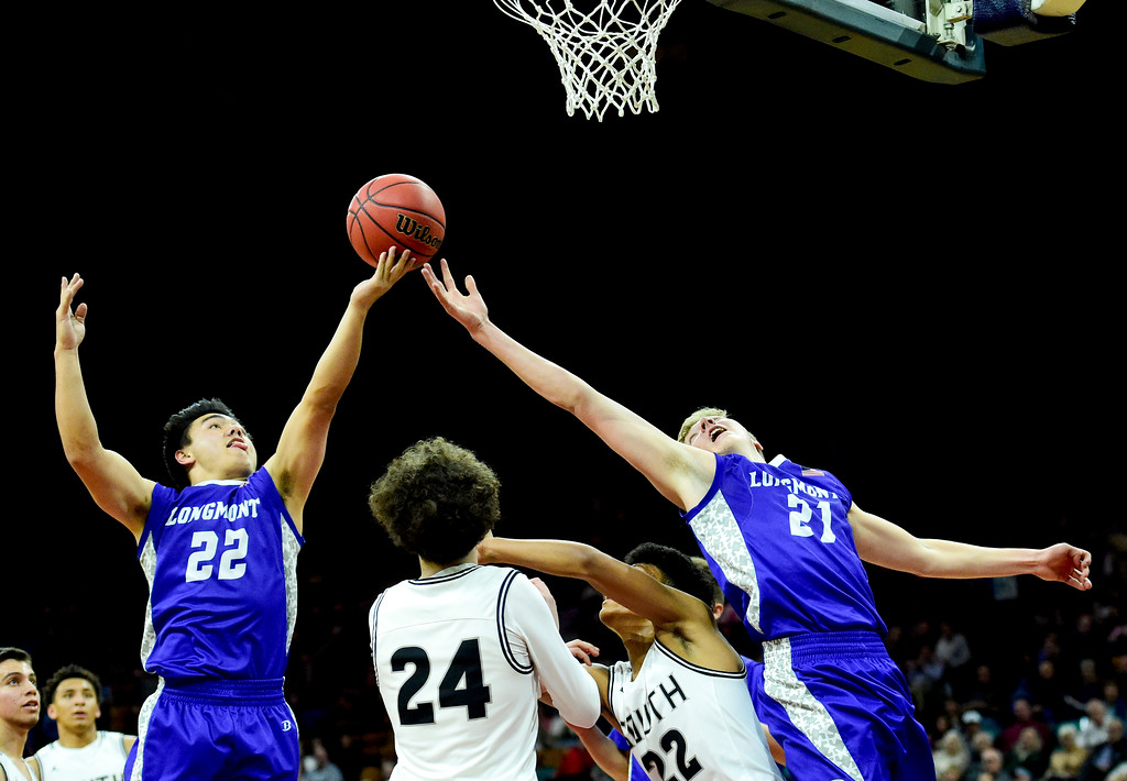 . Longmont High School\'s Oakley Dehning (No. 22) and Dallas Dye (No. 21) grab a rebound from Pueblo South High School in the class 4A state basketball final four game at the Denver Coliseum in Denver, Colorado on March 9, 2018. (Photo by Matthew Jonas/Staff Photographer)