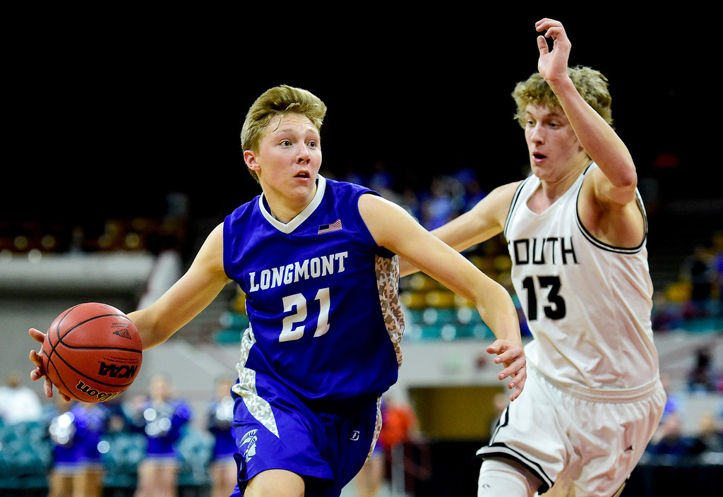 . Longmont High School\'s Dallas Dye (No. 21) drives around Pueblo South High School\'s Jeremy Cody (No. 13) in the class 4A state basketball final four game at the Denver Coliseum in Denver, Colorado on March 9, 2018. (Photo by Matthew Jonas/Staff Photographer)