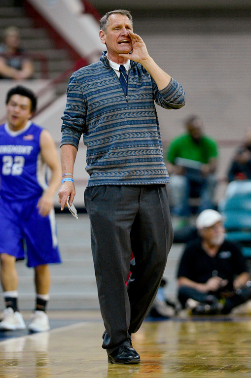 . Longmont High School\'s head coach Jeff Kloster calls out a play in the game against Pueblo South High School in the class 4A state basketball final four game at the Denver Coliseum in Denver, Colorado on March 9, 2018. (Photo by Matthew Jonas/Staff Photographer)
