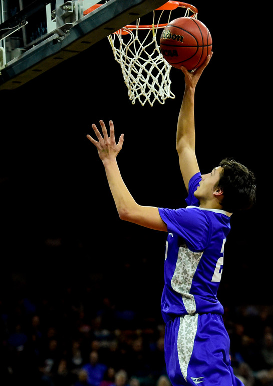 . Longmont High School\'s (No. 25) puts in a basket against Pueblo South High School in the class 4A state basketball final four game at the Denver Coliseum in Denver, Colorado on March 9, 2018. (Photo by Matthew Jonas/Staff Photographer)