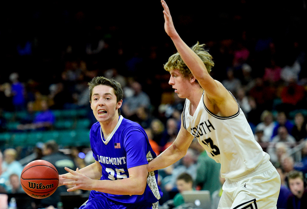 . Longmont High School\'s Calvin Seamons (No. 35) drives around Pueblo South High School\'s Jeremy Cody (No. 13) in the class 4A final four state basketball game at the Denver Coliseum in Denver, Colorado on March 9, 2018. (Photo by Matthew Jonas/Staff Photographer)