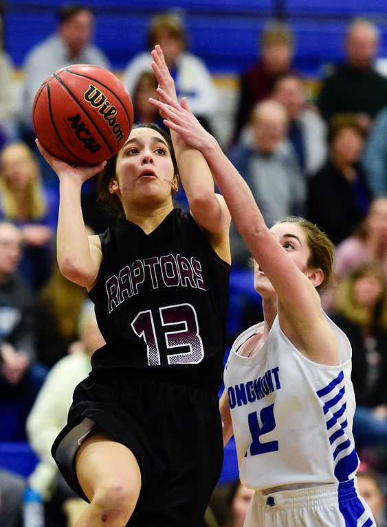 . LONGMONT, CO - JANUARY 30:Silver Creek High School\'s Savana Trujillo (No. 13) shoots over Longmont High School\'s Tara Hitchcock (No. 12) in Longmont on Jan. 30, 2019. (Photo by Matthew Jonas/Staff Photographer)
