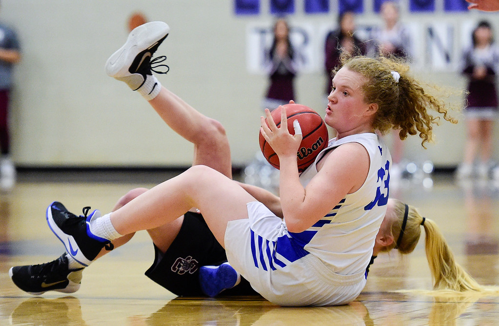 . LONGMONT, CO - JANUARY 30:Longmont High School\'s (No. 33) looks to pass after recovering the ball from Silver Creek High School\'s Monet Becvar (No. 30) in Longmont on Jan. 30, 2019. (Photo by Matthew Jonas/Staff Photographer)