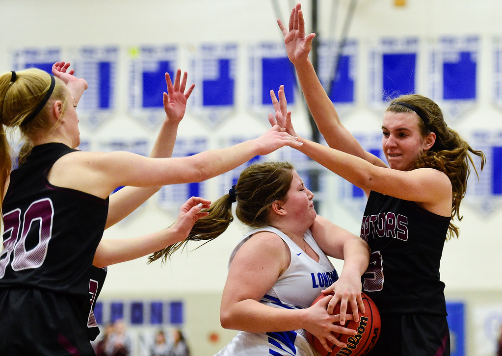 . LONGMONT, CO - JANUARY 30:Silver Creek High School\'s Mackenzie Larson (No. 3) collides with Longmont High School\'s Tanna Carson (No. 24) in Longmont on Jan. 30, 2019. (Photo by Matthew Jonas/Staff Photographer)