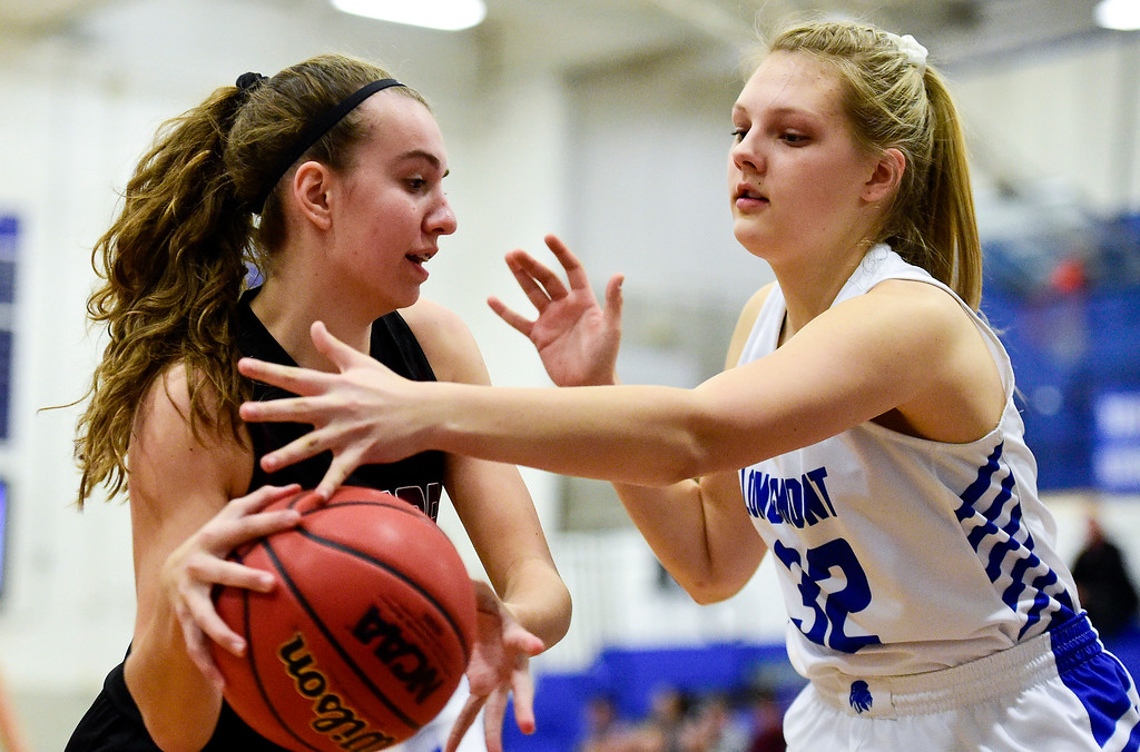 . LONGMONT, CO - JANUARY 30:Longmont High School\'s Jordynn Lee (No. 32) tries to block a pass from Silver Creek High School\'s Mackenzie Larson (No. 3) in Longmont on Jan. 30, 2019. (Photo by Matthew Jonas/Staff Photographer)