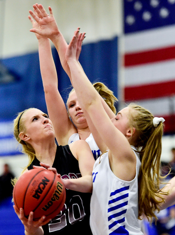 . LONGMONT, CO - JANUARY 30:Silver Creek High School\'s Monet Becvar (No. 30) looks to shoot past  Longmont High School\'s Annika Wetterstrom (No. 10) and  Sarah Wormke (No. 14) in Longmont on Jan. 30, 2019. (Photo by Matthew Jonas/Staff Photographer)