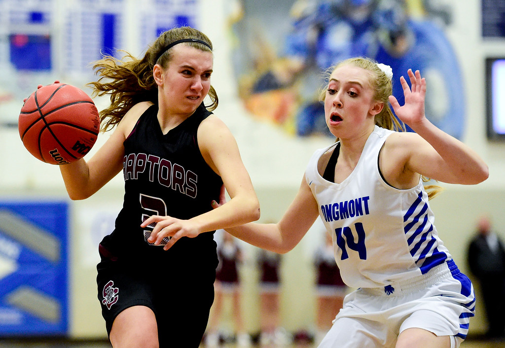 . LONGMONT, CO - JANUARY 30:Silver Creek High School\'s Mackenzie Larson (No. 3) drives around Longmont High School\'s Sarah Wormke (No. 14) in Longmont on Jan. 30, 2019. (Photo by Matthew Jonas/Staff Photographer)