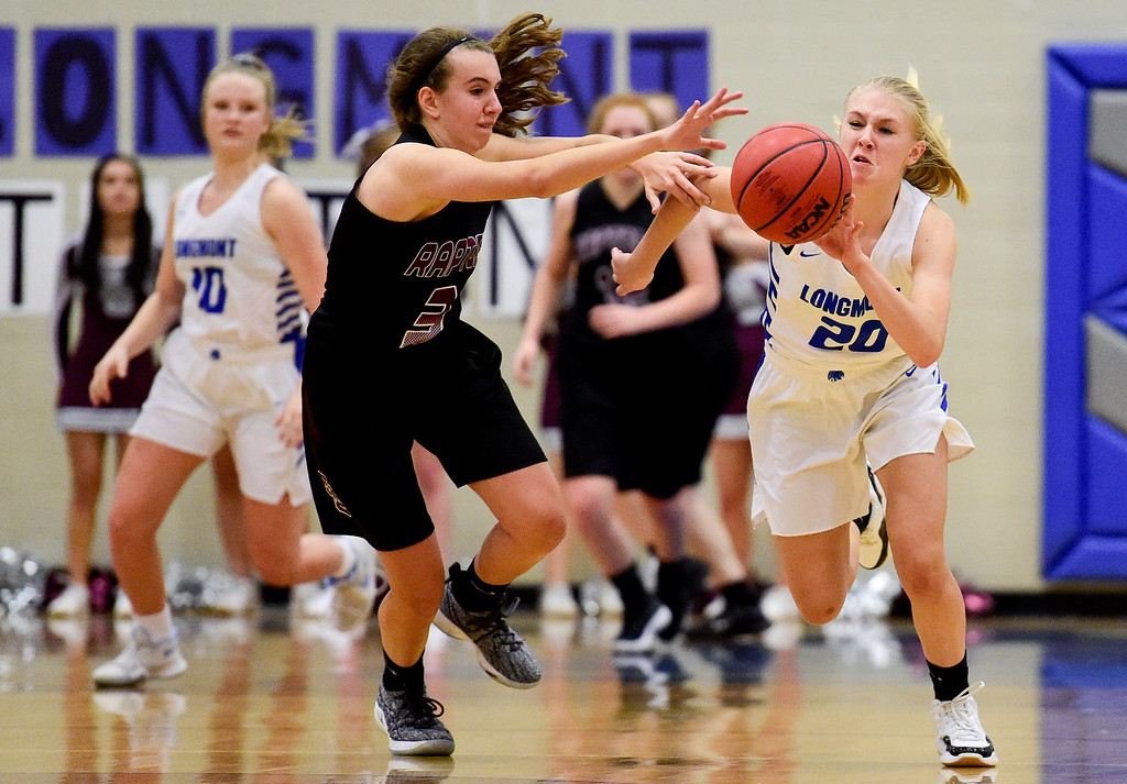 . LONGMONT, CO - JANUARY 30:Silver Creek High School\'s Mackenzie Larson (No. 3) battles for control of the ball with Longmont High School\'s Sally Marshall (No. 20) in Longmont on Jan. 30, 2019. (Photo by Matthew Jonas/Staff Photographer)