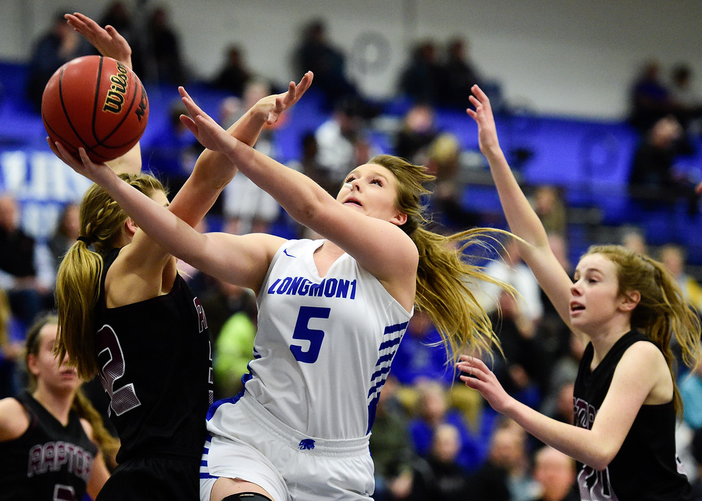 . LONGMONT, CO - JANUARY 30:Longmont High School\'s (No. 5) shoots between Silver Creek High School\'s Emmaline Hawley (No. 32) and Grace McCaffrey (No. 20) in Longmont on Jan. 30, 2019. (Photo by Matthew Jonas/Staff Photographer)