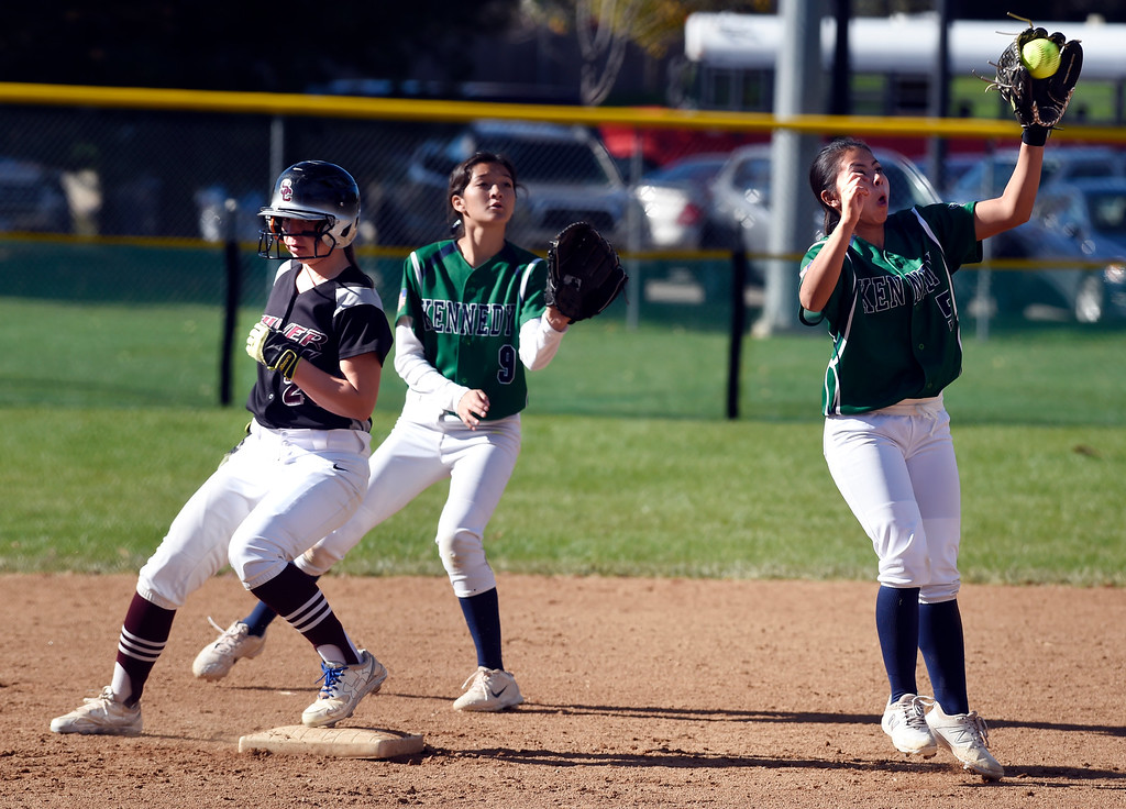 . LONGMONT, CO: October 13, 2018: Jordan Fisher, left, of Silver Creek, is safe a second as the throw is late to Ariana Torres, of JFK High, during regional games on October 13, 2018. (Photo by Cliff Grassmick/Staff Photographer)