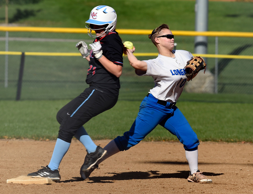 . LONGMONT, CO: October 13, 2018:   Ayahna Bustamante, left, of Longmont, turns a double play with Leanna Lang, of Weld Central coming into second during regional games on October 13, 2018. (Photo by Cliff Grassmick/Staff Photographer)