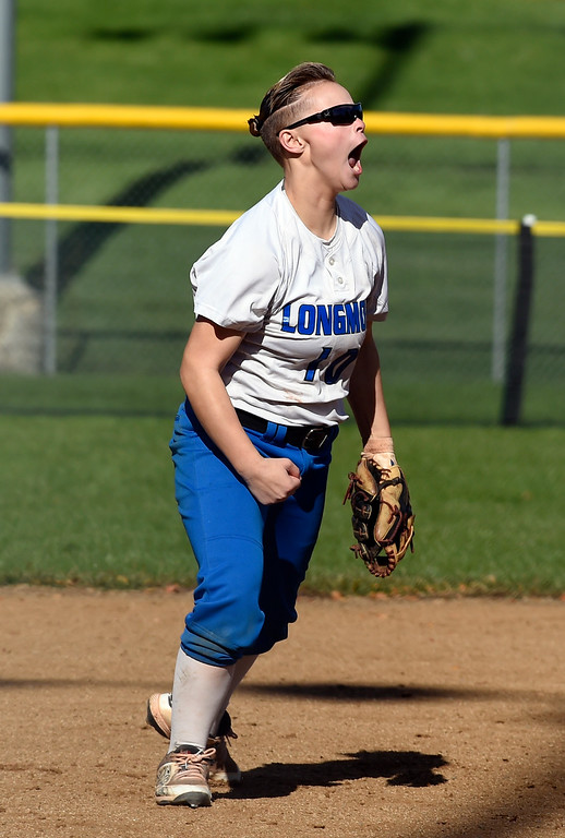 . LONGMONT, CO: October 13, 2018:  Ayahna Bustamante, of Longmont, celebrates a double play during regional games on October 13, 2018. (Photo by Cliff Grassmick/Staff Photographer)