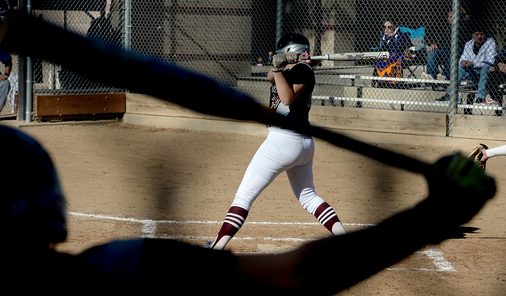 . LONGMONT, CO: October 13, 2018: Bailey Beavers, of Silver Creek, is seen swinging through the silhouette of a teammate during regional games on October 13, 2018. (Photo by Cliff Grassmick/Staff Photographer)