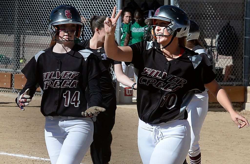 . LONGMONT, CO: October 13, 2018: Jetta Nannen, right, of Silver Creek, holds up two fingers possibly to represent the two home runs she hit in the game on October 13, 2018 against JFK High. Julia Gilson is on the left. (Photo by Cliff Grassmick/Staff Photographer)
