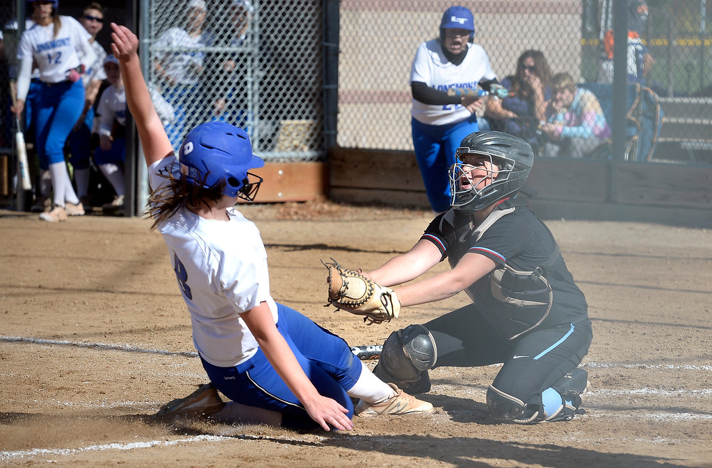 . LONGMONT, CO: October 13, 2018:  Alexa Nielsen, left, of Longmont, is tagged out at home by Sydnie Pevler, of Weld Central, during regional games on October 13, 2018. (Photo by Cliff Grassmick/Staff Photographer)