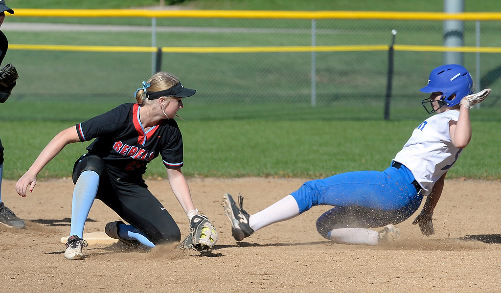. LONGMONT, CO: October 13, 2018: Grace Morrow, of Longmont, is safe at second with a late tag by Carly Powley, of Weld Central, during regional games on October 13, 2018. (Photo by Cliff Grassmick/Staff Photographer)