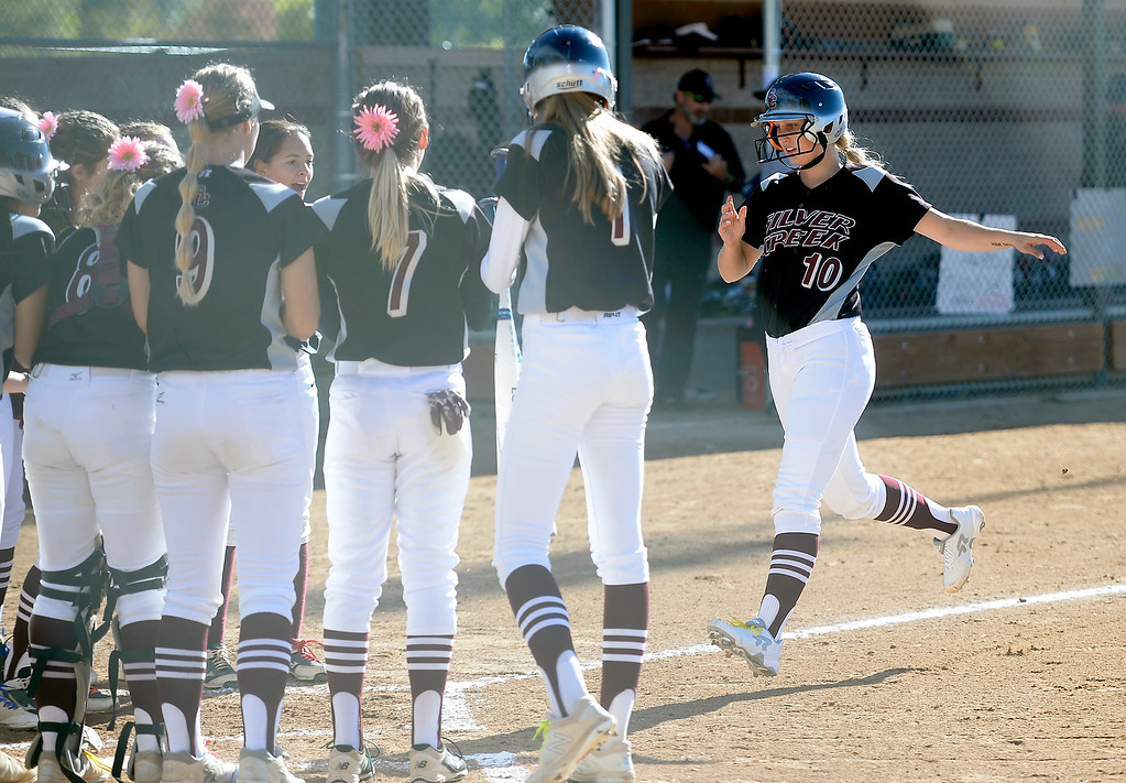 . LONGMONT, CO: October 13, 2018: Jetta Nannen, right, of Silver Creek, comes in after a 2-run home run during regional games on October 13, 2018. (Photo by Cliff Grassmick/Staff Photographer)