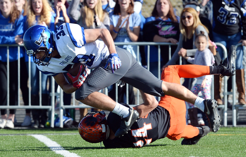 . Cruz Garcia, of Longmont, tries to run through Alexander Mathis, of Erie, during the 3A semifinals at Erie High School on Saturday. For more photos, go to BoCoPreps.com  Cliff Grassmick / Staff Photographer/ November 25, 2017, 2017