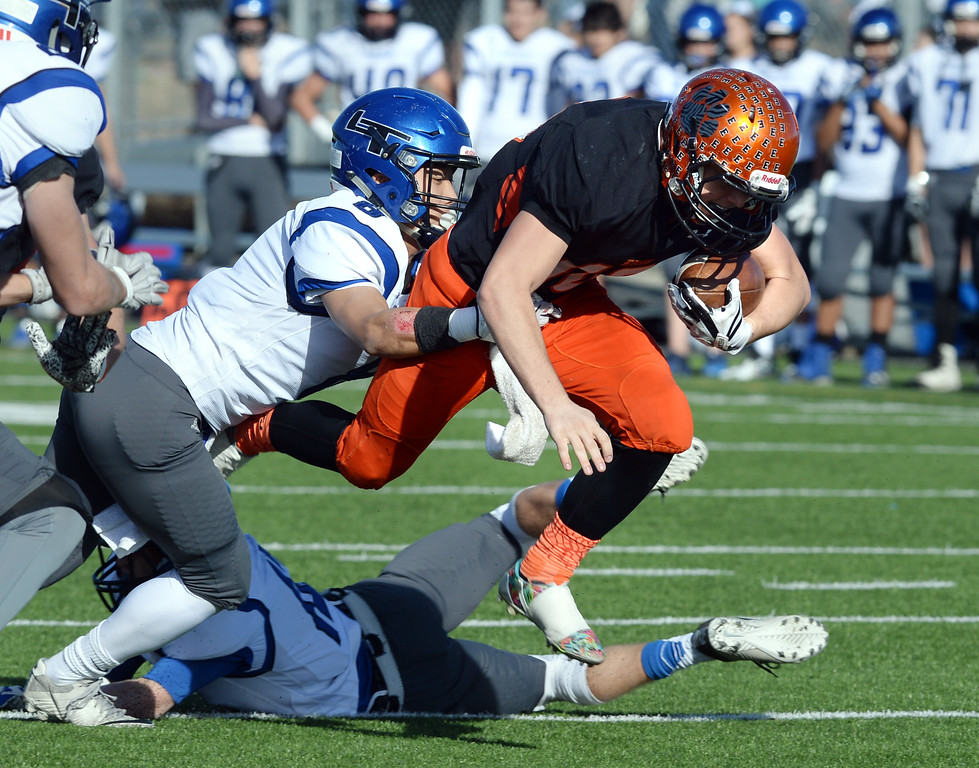 . Jacob Mansdorfer, of Erie, gets some air trying to get a first down against Longmont during the 3A semifinals at Erie High School on Saturday. For more photos, go to BoCoPreps.com  Cliff Grassmick / Staff Photographer/ November 25, 2017, 2017