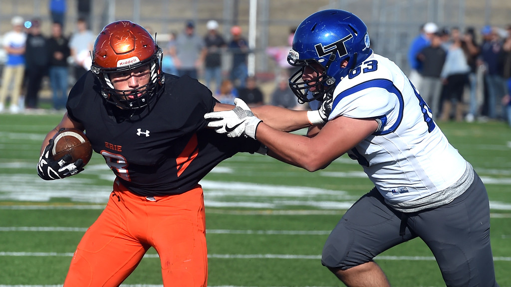 . Noah Roper, of Erie, tries to pull away from Maxton Parr, of Longmont, during the 3A semifinals at Erie High School on Saturday. For more photos, go to BoCoPreps.com  Cliff Grassmick / Staff Photographer/ November 25, 2017, 2017