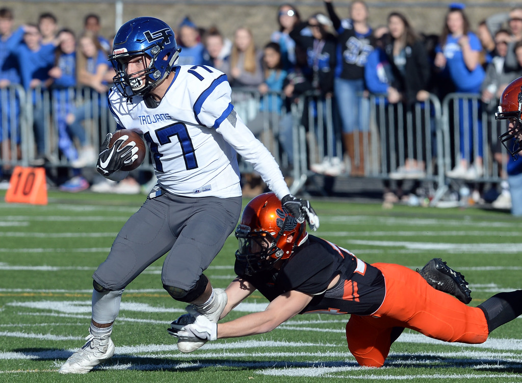 . Sage Yazzie, of Longmont, tries to escape the Erie defender during the 3A semifinals at Erie High School on Saturday. For more photos, go to BoCoPreps.com  Cliff Grassmick / Staff Photographer/ November 25, 2017, 2017