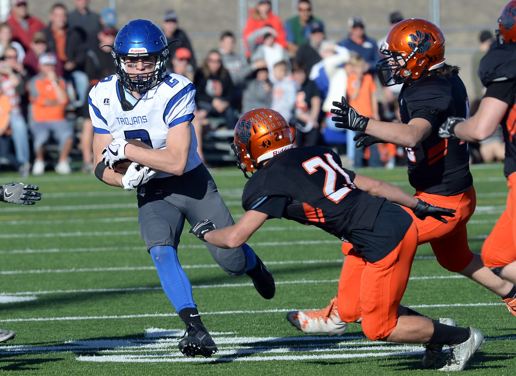 . Danny Nichols, of Longmont, runs back a punt, as Preston Vanlandingham, of Erie, tries to make the tackle during the 3A semifinals at Erie High School on Saturday. For more photos, go to BoCoPreps.com  Cliff Grassmick / Staff Photographer/ November 25, 2017, 2017