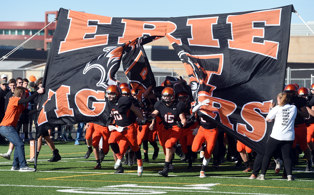 . The Erie Tigers enter the stadium during the 3A semifinals at Erie High School on Saturday. For more photos, go to BoCoPreps.com  Cliff Grassmick / Staff Photographer/ November 25, 2017, 2017