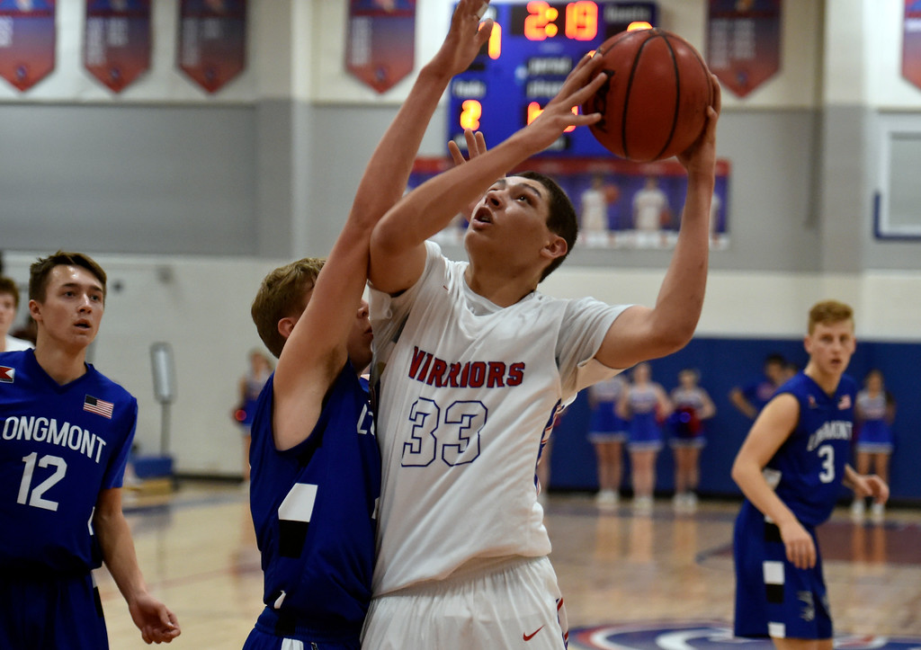. LAFAYETTE, CO - FEBRUARY 5, 2019: A Centaurus High School player, not on roster, goes for a layup over Dallas Dye during a CHSAA basketball game against Longmont on Tuesday in Lafayette. More photos: BoCoPreps.com (Photo by Jeremy Papasso/Staff Photographer)